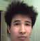 asian guy with a semi fro