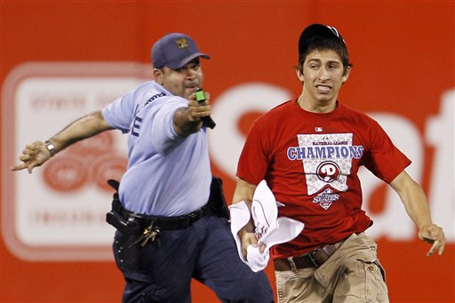 Cop taseing a Phillies fan for running around the field